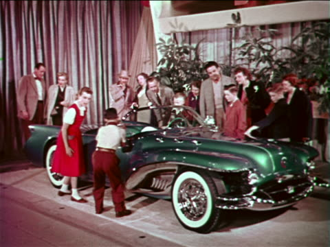 """1954 people crowding around green buick wildcat """"car of the future"""" at motorama / industrial - 1954 stock-videos und b-roll-filmmaterial"""