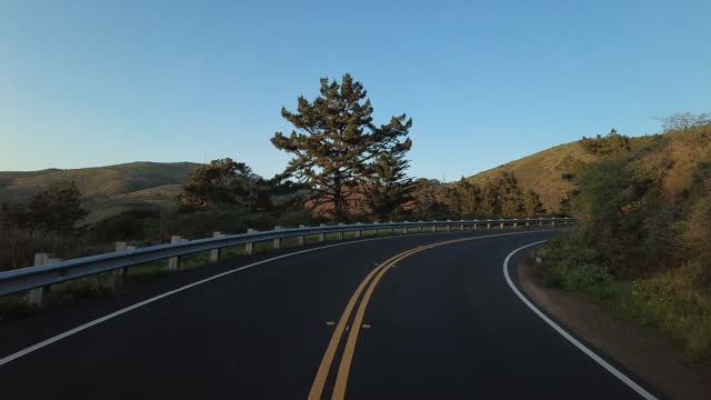 people cycle on the mountain road in the early morning near the golden gate bridge in san francisco amid the coronavirus pandemic. - winding road stock videos & royalty-free footage
