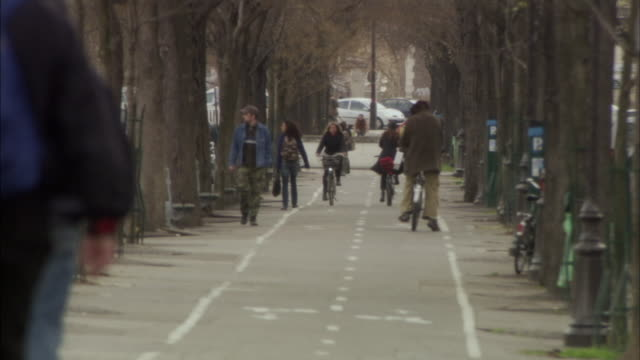 WS People cycling in bike lane, Paris, France
