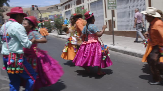 people dance and play instruments in street for carnival celebration in chile - lateinamerika stock-videos und b-roll-filmmaterial