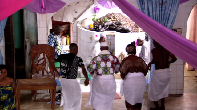 people dance at a voodoo ceremony. available in hd. - benin stock videos and b-roll footage