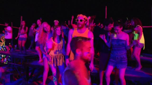 people dance during the full moon party on the beach on ko phangan in thailand on jan 4 2015 - political party stock videos & royalty-free footage