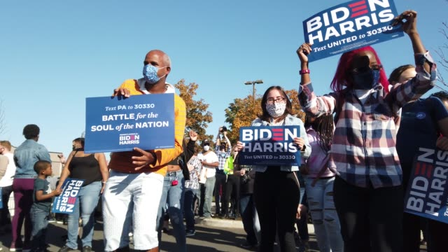 people dance to music and hold biden harris signs as they celebrate the news that democratic presidential nominee joe biden has seemingly won the... - celebration stock videos & royalty-free footage
