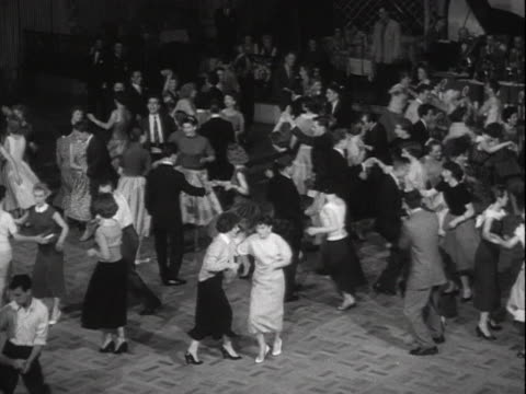 people dance to rock and roll music in a dance hall. - early rock & roll stock videos & royalty-free footage