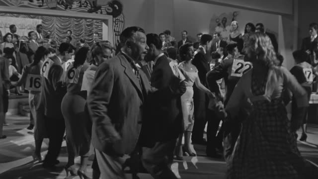 """people dancing a """"cha cha cha"""" song in a dancing contest in 1950s. - contestant stock videos & royalty-free footage"""