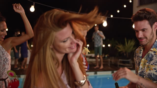 people dancing and laughing at a party by the pool at night - wrap dress stock videos and b-roll footage