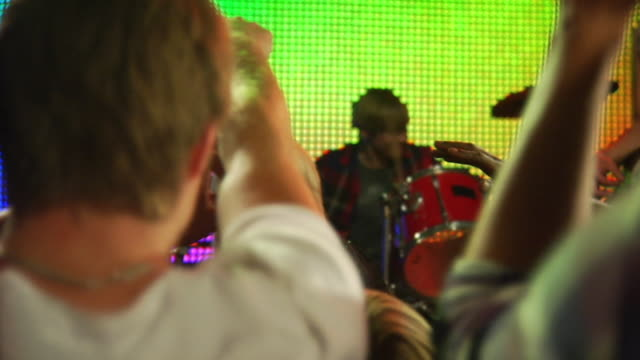 ms slo mo people dancing at rock concert / london, uk  - fame stock-videos und b-roll-filmmaterial