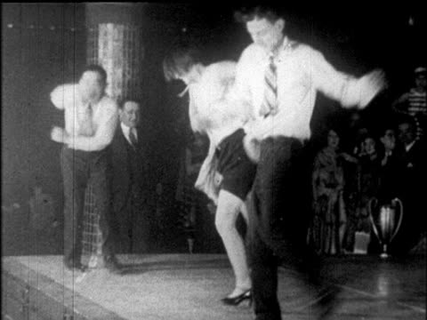 vídeos de stock, filmes e b-roll de b/w 1925 people dancing charleston at dance marathon / roseland ballroom, nyc / newsreel - 1920