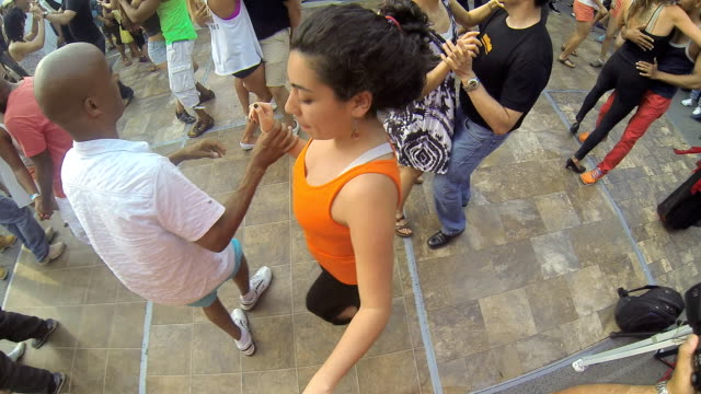 people dancing in a dj booth in salsa on saint clair avenue west festival which is the largest hispanic or latin event in canada this year one of the... - salsa stock videos & royalty-free footage