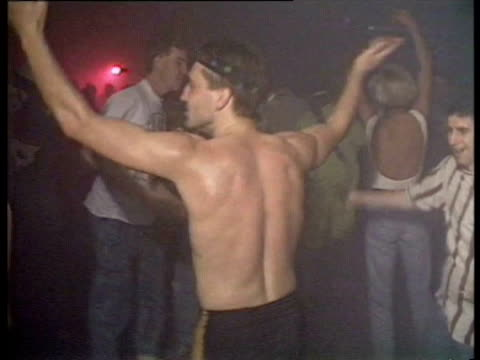 People dancing in acid house rave man dancing without a shirt / 80s dance scene People dancing in Acid House on October 04 1988 in London