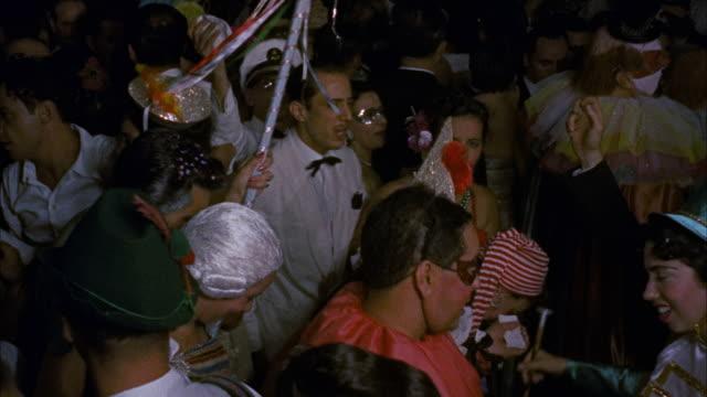cu people dancing in carnival ball / unspecified - 舞踏会点の映像素材/bロール
