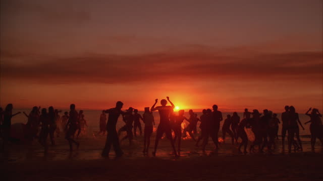 WS People dancing on beach