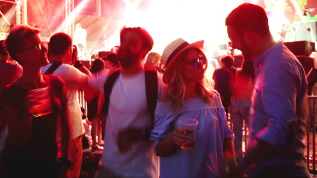 people dancing on festival and drinking beer - lightship stock videos & royalty-free footage