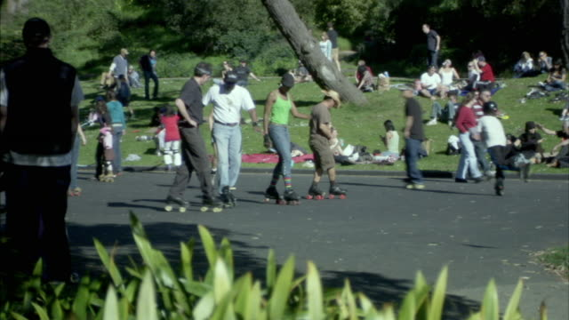 ms people dancing on roller skates on park path, san francisco, california, usa - blade stock videos & royalty-free footage
