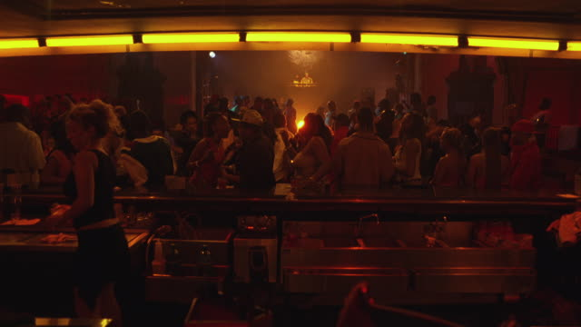 people dancing on the dance floor of a nightclub. - nightlife stock videos & royalty-free footage