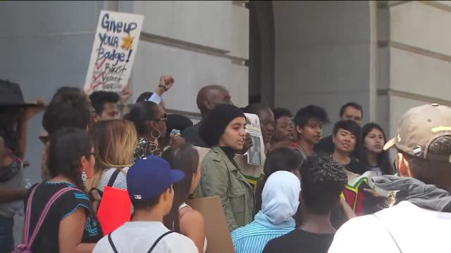 people demonstrated outside of city hall against killings by police. - los angeles police department stock videos & royalty-free footage