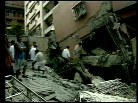 people desperately search through rubble in search of victims following earthquake chi chi 23 september 1999 - taiwan stock videos & royalty-free footage