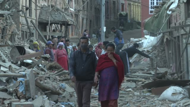 People dig out and recover property from a destroyed homes / A major earthquake hit Kathmandu midday on Saturday April 25th and was followed by...