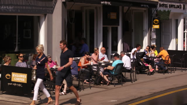 people dine outside of a cafe in windsor, england. - healthcare and medicine or illness or food and drink or fitness or exercise or wellbeing stock videos & royalty-free footage