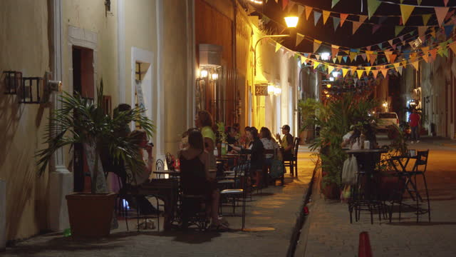 people dining at a sidewalk cafe: nightlife in valladolid, mexico - patio stock videos & royalty-free footage