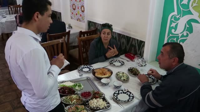 People dining in a restaurant which serves traditional Uzbek food in the old city of Bukhara in Uzbekistan