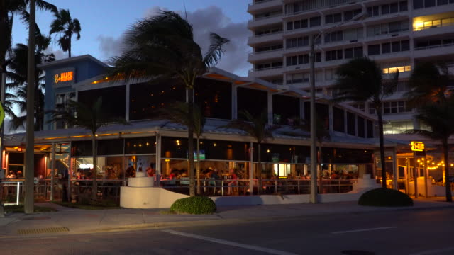 people dining outdoors at bo's beach restaurant on fort lauderdale beach boulevard on october 9 fort lauderdale florida restaurants continue to offer... - scott mcpartland stock videos & royalty-free footage