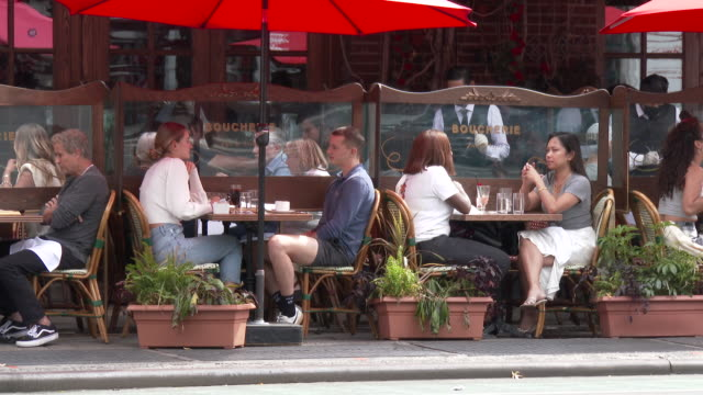 people dining outdoors at boucherie restaurant on 7th avenue south on september 26, 2020 in the west village, new york, new york. restaurants... - 7th avenue stock videos & royalty-free footage