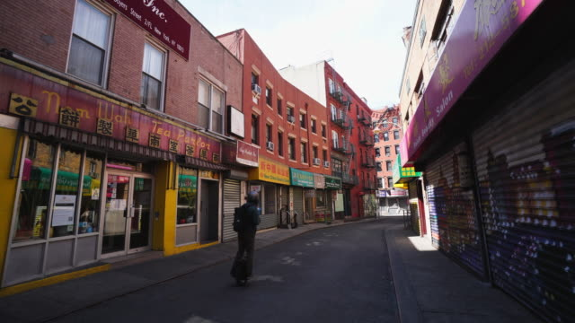 people disappear from china town street for impact of the quarantine for new york state on pause order of covid-19 at new york city ny usa on may. 20 2020. - chinatown stock videos & royalty-free footage