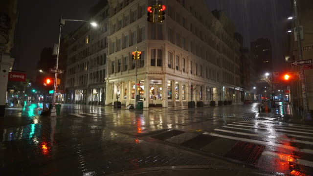 stockvideo's en b-roll-footage met people disappeared from town in the rainy night for impact of covid-19 in soho district new york city ny usa on mar. 19 2020. - zonder mensen