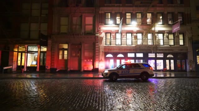 people disappeared from town in the rainy night for impact of covid-19 in soho district new york city ny usa on mar. 19 2020. - crime stock videos & royalty-free footage
