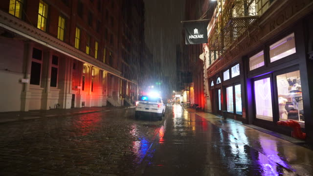 people disappeared from town in the rainy night for impact of covid-19 in soho district new york city ny usa on mar. 19 2020. - alley stock videos & royalty-free footage