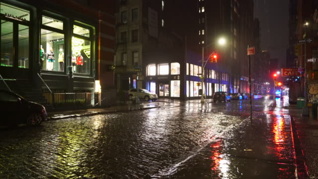 people disappeared from town in the rainy night for impact of covid-19 in soho district new york city ny usa on mar. 19 2020. - rain stock videos & royalty-free footage