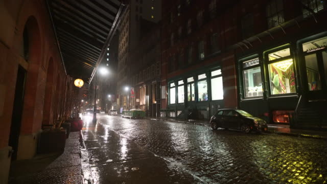 people disappeared from town in the rainy night for impact of covid-19 in soho district new york city ny usa on mar. 19 2020. - road signal stock videos & royalty-free footage