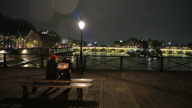 """people discuss on a bench of the """"pont des arts"""", as background the """"pont neuf"""" by night on january 7, 2021 in paris, france. unlike the united... - atmospheric mood stock videos & royalty-free footage"""