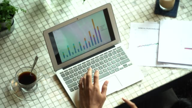 people discussing charts on the table at the meeting - bar chart stock videos & royalty-free footage