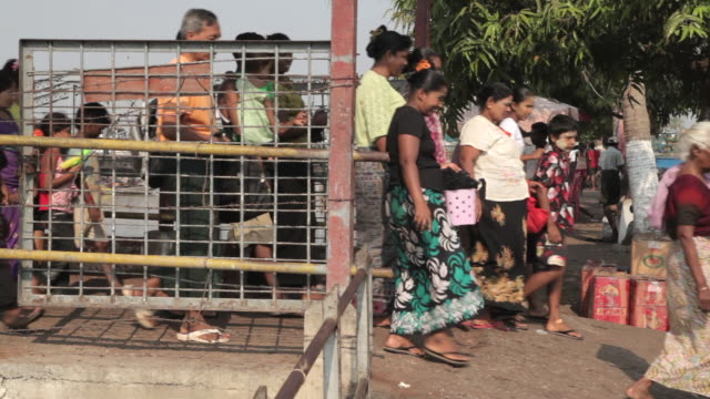 people disembark a passenger ferry at yangon's waterfront - ferry stock videos & royalty-free footage