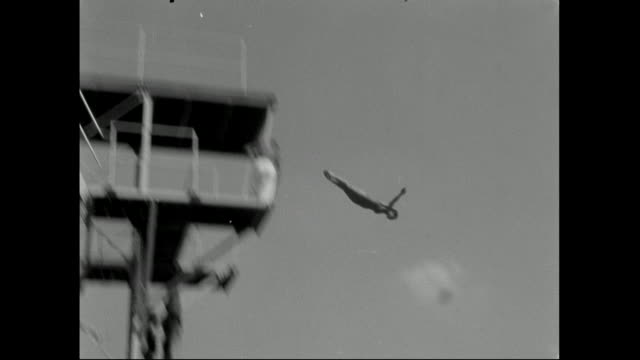 people dive off tall diving platform; 1959 - diving into water stock videos & royalty-free footage
