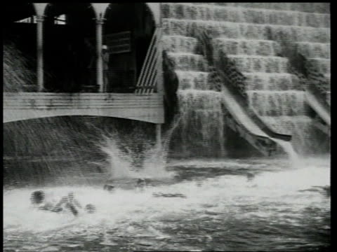 1918 ws people diving and swimming near spraying fountains, with the motion reversing halfway through / brooklyn, new york, united states - 1918 stock videos & royalty-free footage