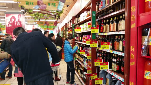 people do the shopping before the chinese lunar new year spring festival as families gather to celebrate the forthcoming chinese spring festival on... - chinese culture stock videos & royalty-free footage