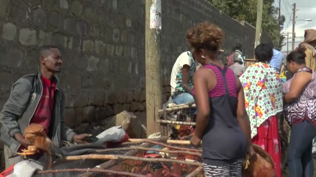 people do their shopping at the sholla bazaar ahead of the new year in addis ababa, ethiopia on january 6, 2016. orthodox christians in the country... - ethiopia stock videos & royalty-free footage