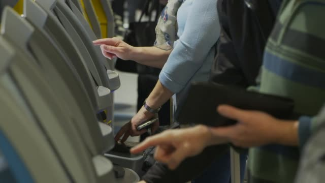 People doing electronic checkin at Gatwick Airport