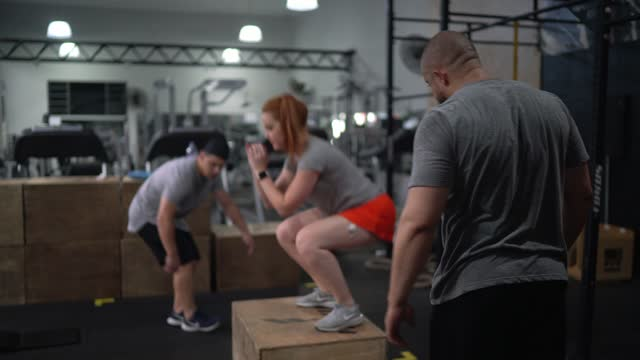 people doing high intensity training at the gym - exercise equipment stock videos & royalty-free footage