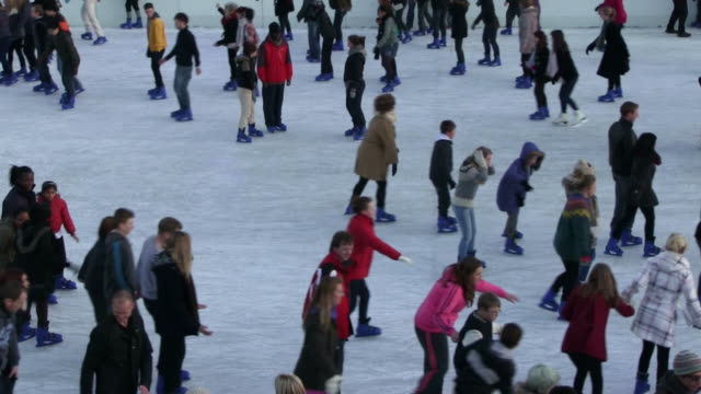 cu people doing ice skating at tower of london/ london, great britain   - ice skating stock videos & royalty-free footage