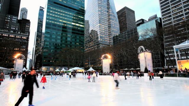 ws people doing  ice skating rink in bryant park christmas / new york, united states - bryant park stock videos and b-roll footage