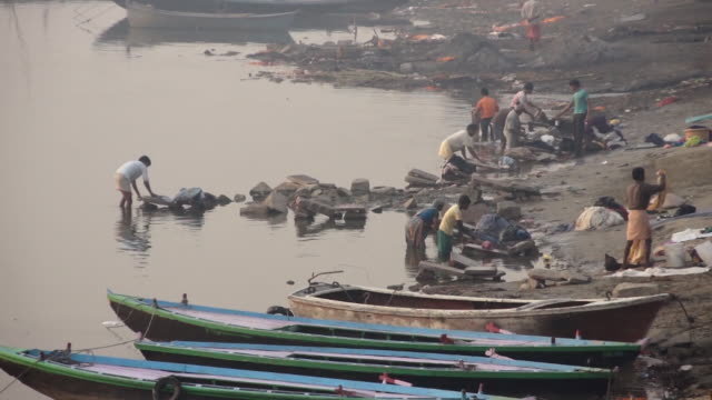 people doing laundry along the ganges river, varanasi, india - water's edge stock videos & royalty-free footage