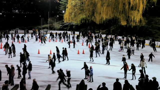ms  people doing skating at wollman ice rink in central park  / new york, united states - ice skating stock videos & royalty-free footage