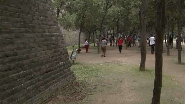 People doing Tai Chi in KibinoMakibi Park Dolly Shot