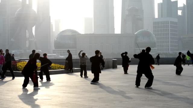 People doing Tai Chi on The Bund, Shanghai, China