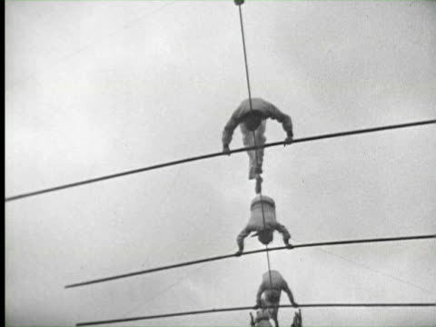 stockvideo's en b-roll-footage met b/w people doing various circus, florida / audio - acrobatiek