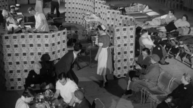 1958 montage people donating blood for the national blood transfusion service / united kingdom - blood donation stock videos and b-roll footage